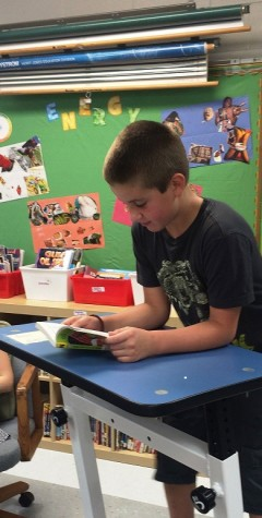Students at Windsor Elementary School in Arlington Heights, Ill., including Adam Boesen, 10, are learning this year with the help of so-called classroom fit stations, including standing desks, exercise bikes and elliptical machines. (Karen Ann Cullotta/Chicago Tribune/TNS)