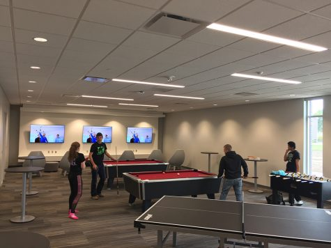 Students playing pool in the Hawk's Point Game Room. Photo by Mark Lange