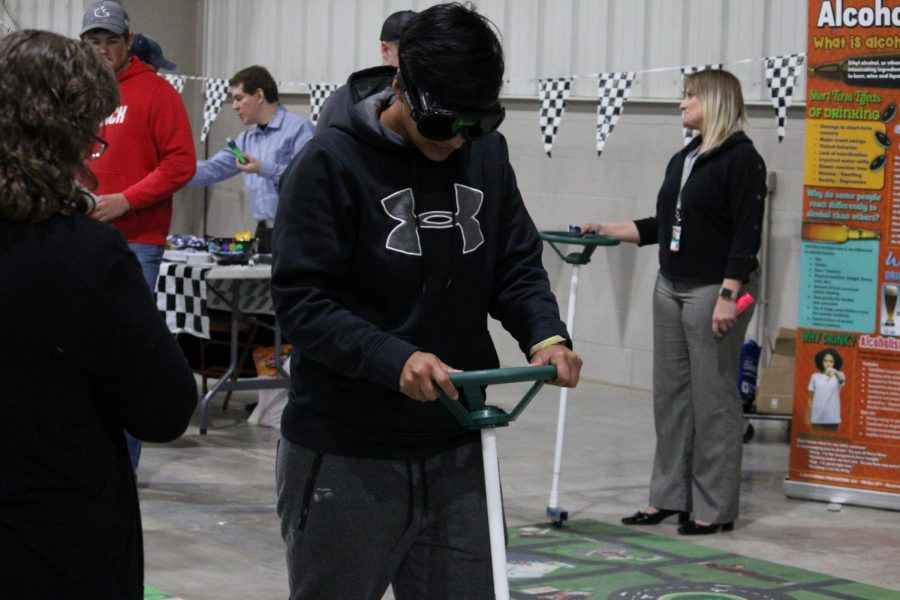 These altering glasses gave the affect of what it would be like if students were high, participating students had to try and stay steady following a path with the guiding stick.