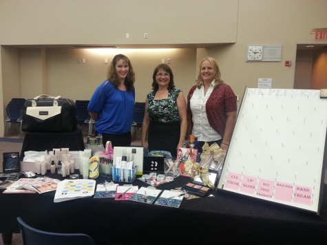 Mary Kay ladies and their booth.