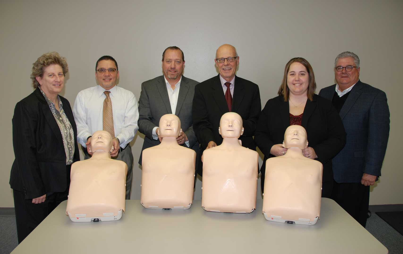"Northeast Community College has received four ""Little Anne"" CPR training units from the National Automobile Dealers Charitable Foundation, the Nebraska New Car and Truck Dealers Association and three Norfolk new car dealerships. Pictured at a recent presentation are (from left) Michele Gill, dean of Health and Wellness at Northeast Community College, Al Rajee, Cornhusker Auto and Cornhusker Imports, Andy Swanson, Norfolk GM Auto Center, Darrell Novacek, Courtesy Ford Lincoln, Heather Claussen, director of Allied Health at Northeast, and Pat Sullivan, Nebraska New Car and Truck Dealers Association. (Courtesy Photo)"