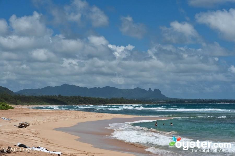 Kauai+Beach+Resort+in+Hawaii%2C+is+a+private%2C+quiet+property+with+large+rooms%2C+gorgeous+sunrises+over+a+rugged+beach%2C+a+water+slide+and+sand-bottom+pool%2C+and+a+romantic+bar+with+live+music.