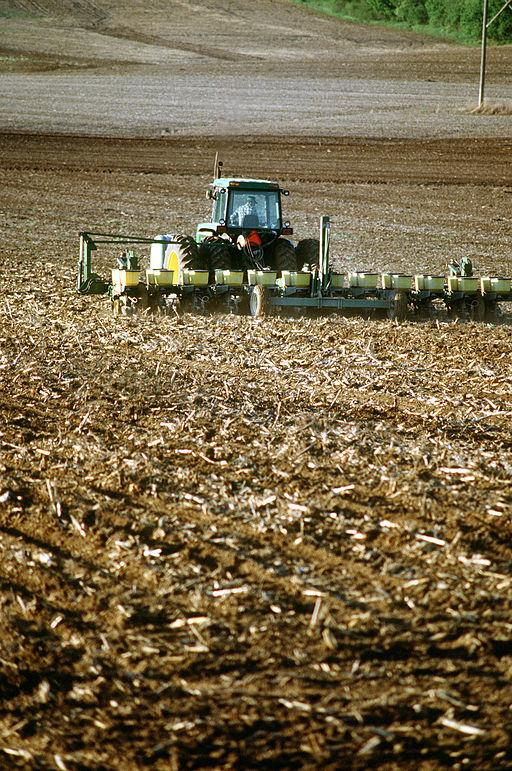 A midwestern farmer tills and fertilizes his land near Omaha, Nebraska.