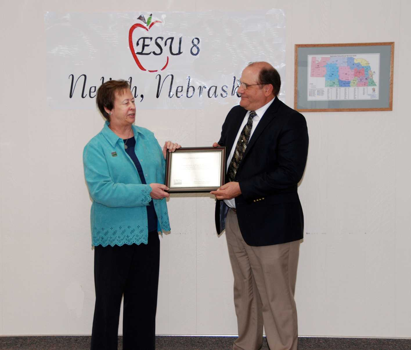 Maxine Moul, USDA Rural Development Nebraska state director, presents a certificate to Bill Mowinkel, administrator of ESU #8, recognizing a $287,442 grant to update ESU #8s distance learning equipment to connect 30 schools with Northeast Community College. It is part of $1.2 million in funding awarded to several ESUs in the state. (Courtesy Photo)