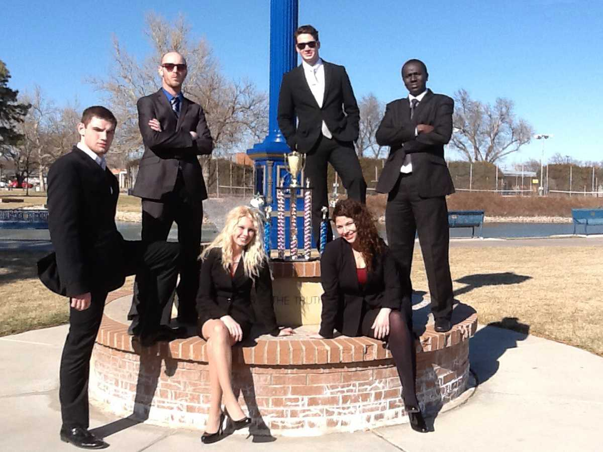 Members of the Northeast Community College speech team pose with their Division II First Place Team Sweepstakes trophy at the Junior Varsity National Tournament in Hutchinson, KS. Members of the team are (standing) Jordan Sager, Norfolk, Joe Lose, Kansas City, MO, Benjamin Temple, Norfolk; and Musa Fofana, Serrekunda, The Gambia. Sitting are Drew Sempek, Stromsburg; and Erica Temple, Norfolk. (Courtesy Terry Nelson Northeast Community College)