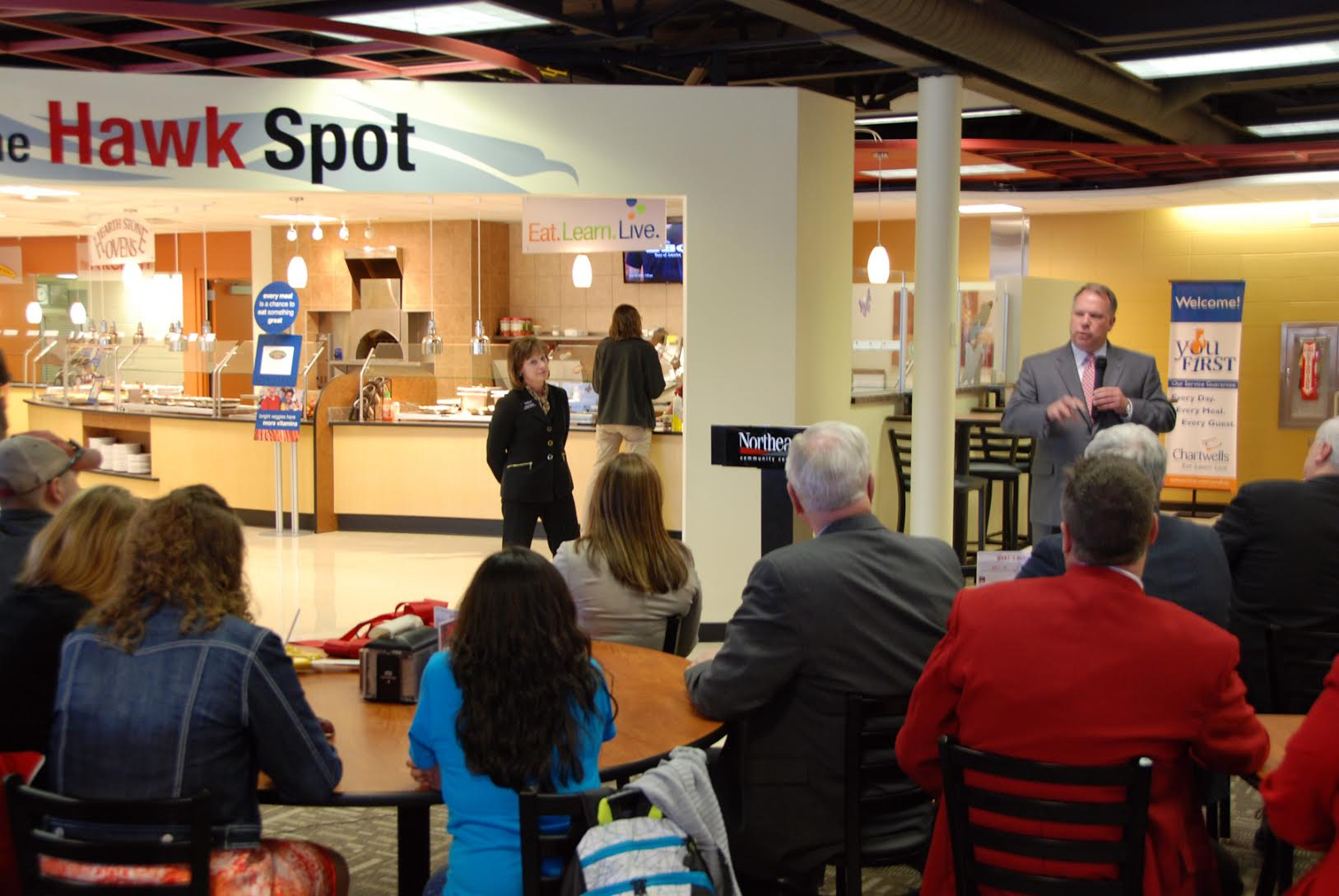 "The dining area at Northeast Community College has a new look, a new menu and a new name.  College officials recently dedicated ""The Hawk Spot,"" located in the Student Center on the Norfolk campus. Dan Eusebio, right, district manager of Chartwells Higher Education Dining Services, speaks during the dedication. Chartwells is Northeast's food service provider. (Courtesy Photo)"