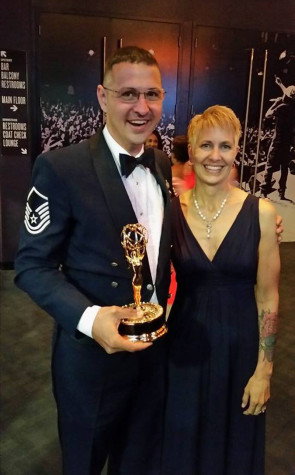 Master Sgt. Loren J. Zimmer, an audio engineer with The U.S. Air Force Band, Joint Base Anacostia-Bolling, Washington, D.C., holds a regional Emmy Award that he earned with four colleagues for a program that aired in 2013 on Maryland Public Television. The Eagle, NE, native is a 1998 graduate of the audio recording technology program at Northeast Community College in Norfolk. He is pictured with his wife, Lisa. (Courtesy Photo)