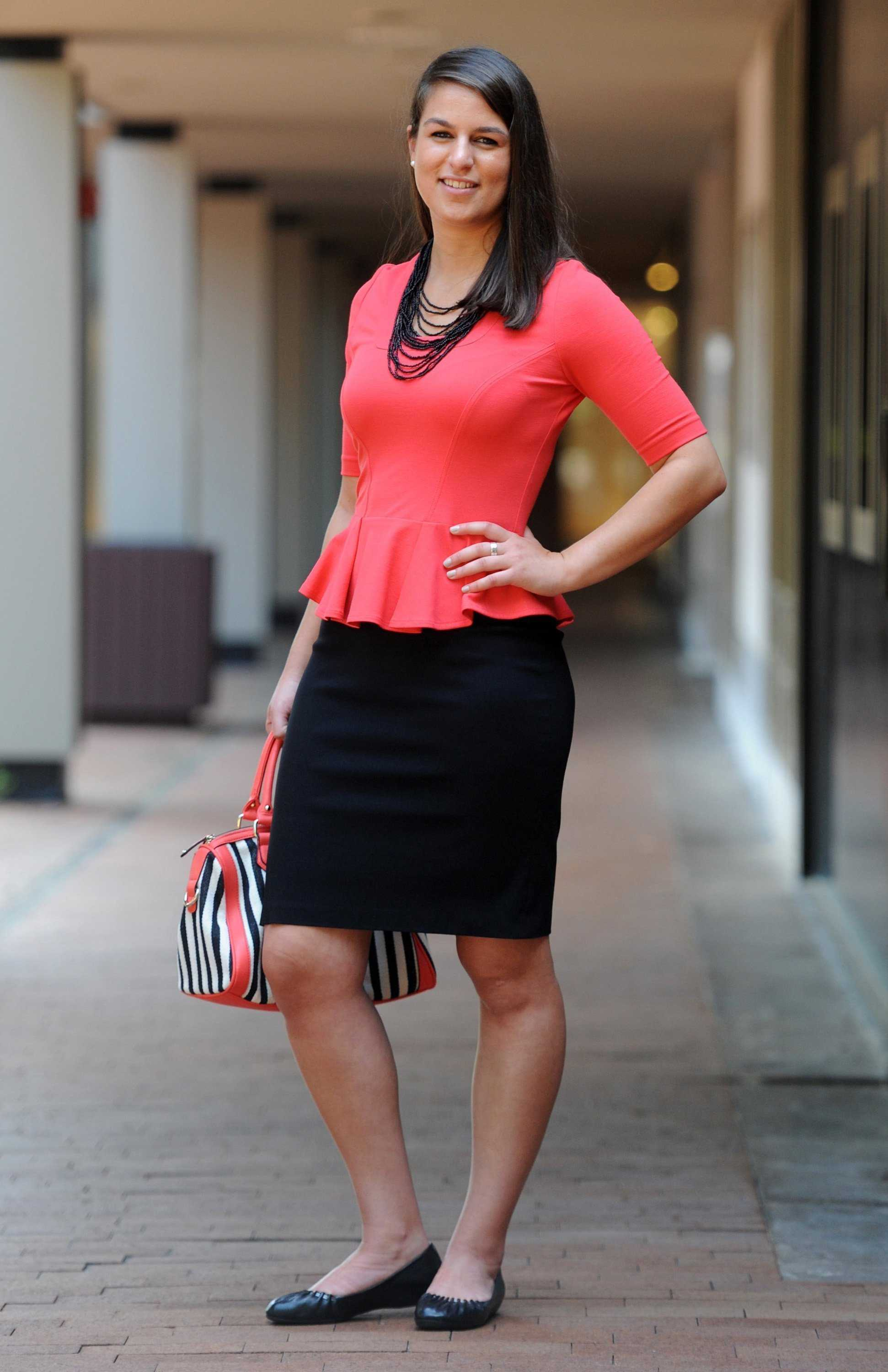 Recent college graduates need to find the right way to stay stylish, yet professional, for the workplace. A Yoanna Barchi peplum top and skirt by Equestrian are paried with a handbag by High Fashion and flats by Steve Madden. (Kim Hairston/Baltimore Sun/MCT)