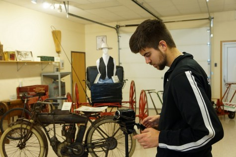 Digital Cinema student Bryce Eisenmenger takes video among the historic vehicles at the Elkhorn Valley Museum