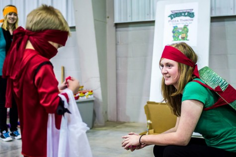 SGA member and Ninja Turtle Rachel Frederick helps a Red Ninja Avenger with his candy