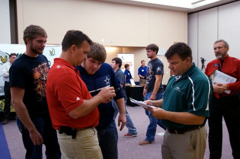 Dr. Burton Pflueger (right) looks on as Ag Coop professionals talk to Northeast Ag students