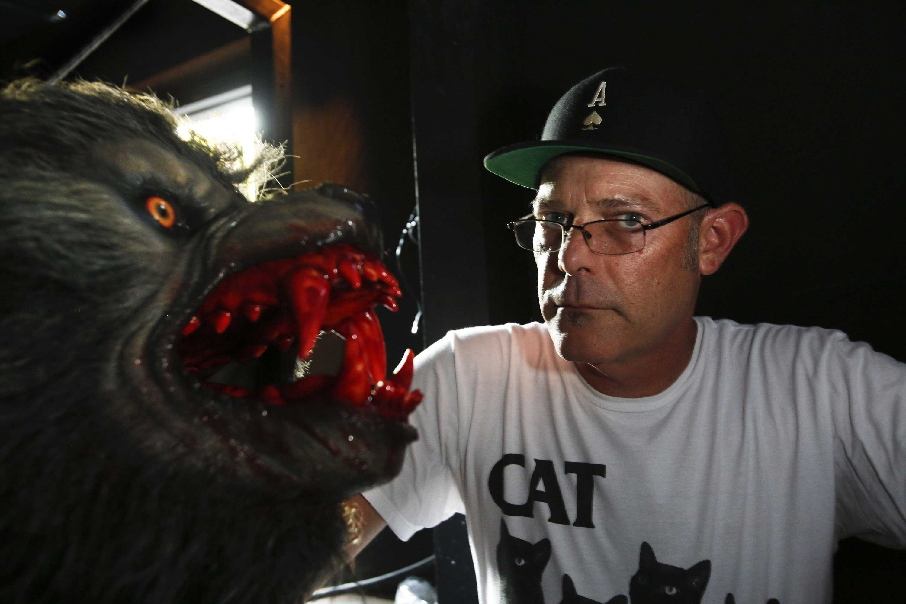 John Murdy, executive producer of Halloween Horror Nights at Universal Studios Hollywood, with one of many werewolves during a tour of the mazes that are being set up around the theme of the horror movie