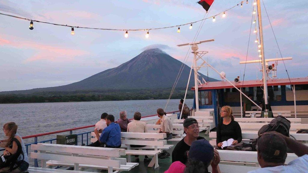The Concepcion Volcano looms in the background as a ferry approaches Nicaragua's Ometepe Island on August 12, 2014. The island is a paradise for adventurers and nature lovers