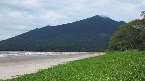 The Maderas Volcano looms at the end of a beach on Ometepe Island in Nicaragua on August 14, 2014.