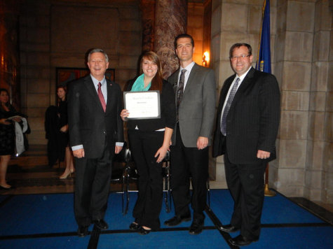 Beth Ebmeier receives an award from the Nebraska State Board of Education. From left - Governor Dave Heineman, Beth Ebmeier, Dr. Wade Herley - Northeast's Dean of Business & Technology,  Dr. Matthew L. Blomstedt, Nebraska Commissioner of Education