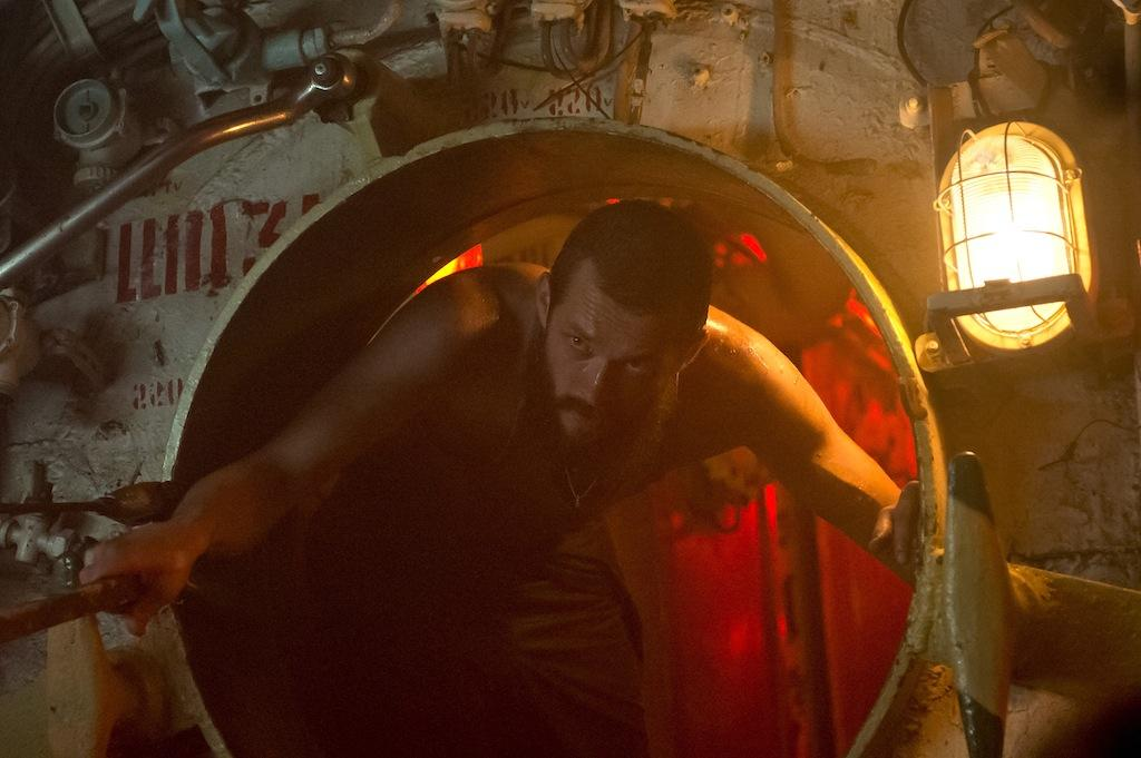 Jude Law stars as a rogue submarine captain after sunken treasure in
