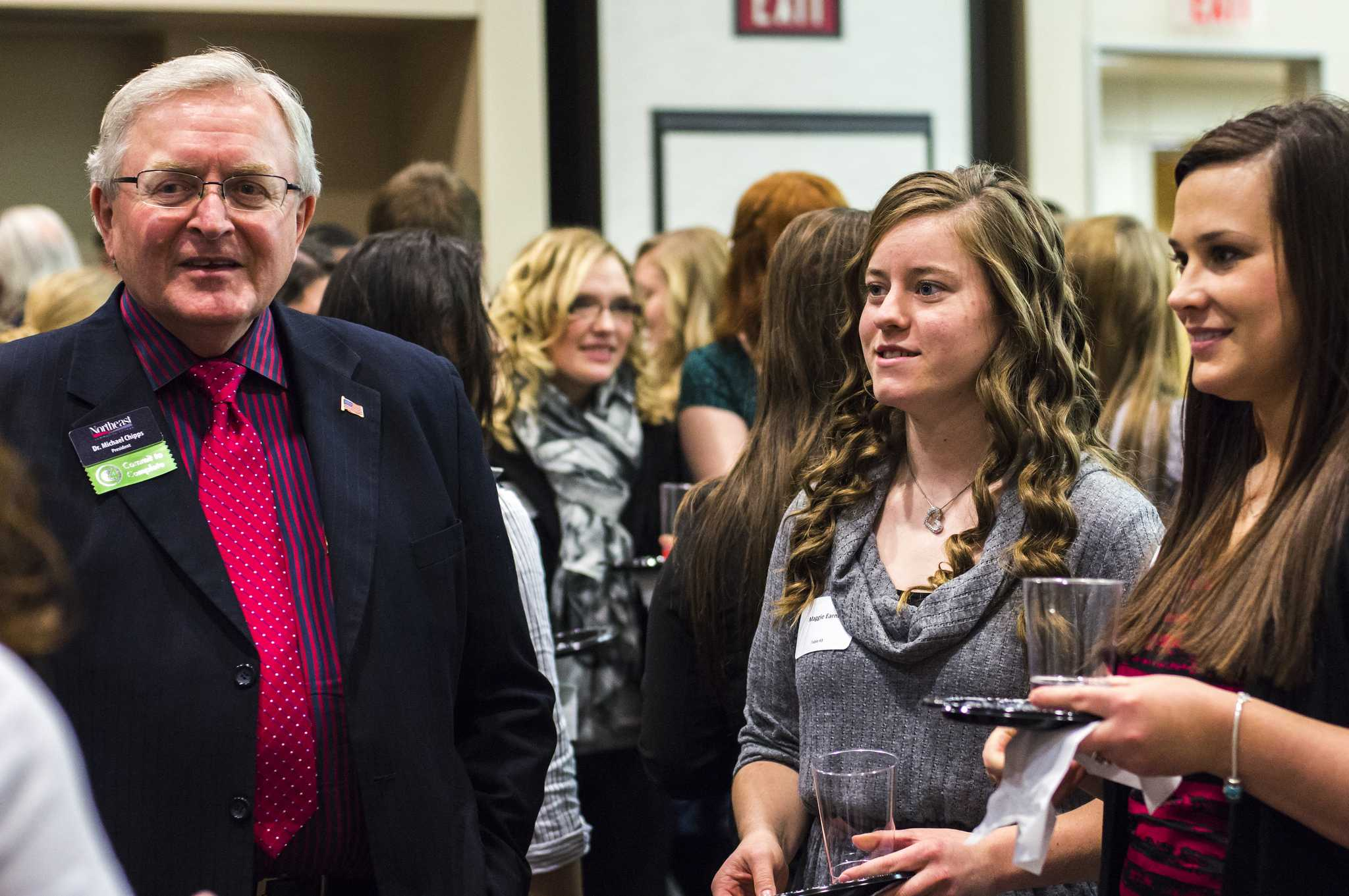 Dr. Chipps chats with students at the Etiquette Dinner last fall.