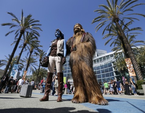 Star Wars fans Sharon Jackson, left, dressed as Mission Vao, and Kyle Jackson, dressed as Chewbacca, at the Star Wars Celebration, April 16-19 at the Anaheim Convention Center in Anaheim, Calif., on Thursday, April 16, 2015.