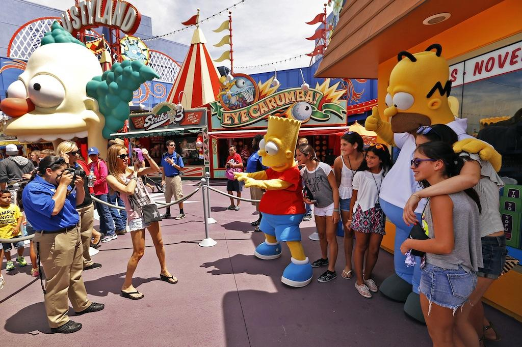 Bart and Homer characters interact and pose with guests at Universal Studios Hollywood. (Al Seib/Los Angeles Times/TNS)