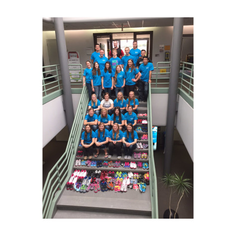 PTA Donates Shoes And Money To Shoes4Kids