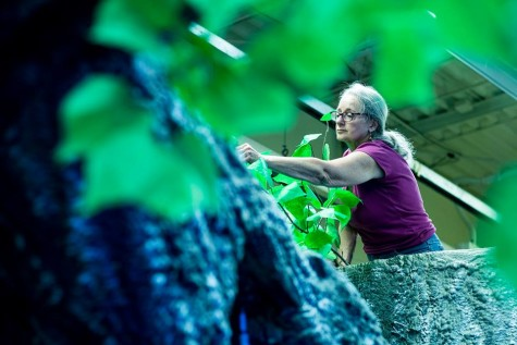 Sue Jochum adding branches to the Northeast Community College Theater tree