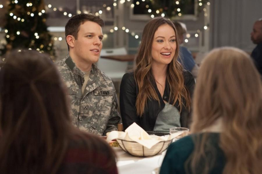 Jake Lacy, left, and Olivia Wilde in Love the Coopers. (CBS Films)