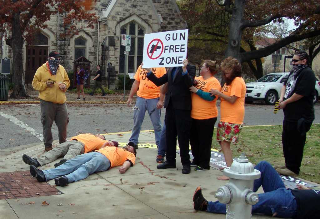 A mock shooting by gun rights activists outside the University of Texas in Austin, Texas, on Saturday, Dec. 12, 2015, to protest gun-free zones drew counter protesters who said it was in poor taste, especially so soon after the mass shooting in San Bernardino, Calif. (Molly Hennessy-Fisk/Los Angeles Times/TNS)