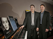 Larry Morton, left, president of Hal Leonard Corp., and Jeff Schroedl, executive vice president, are excited about recent additions to their print music rights to most popular music, including the sheet music for both the new Adele album and the new Star Wars soundtrack. (Rick Wood/Milwaukee Journal Sentinel/TNS)