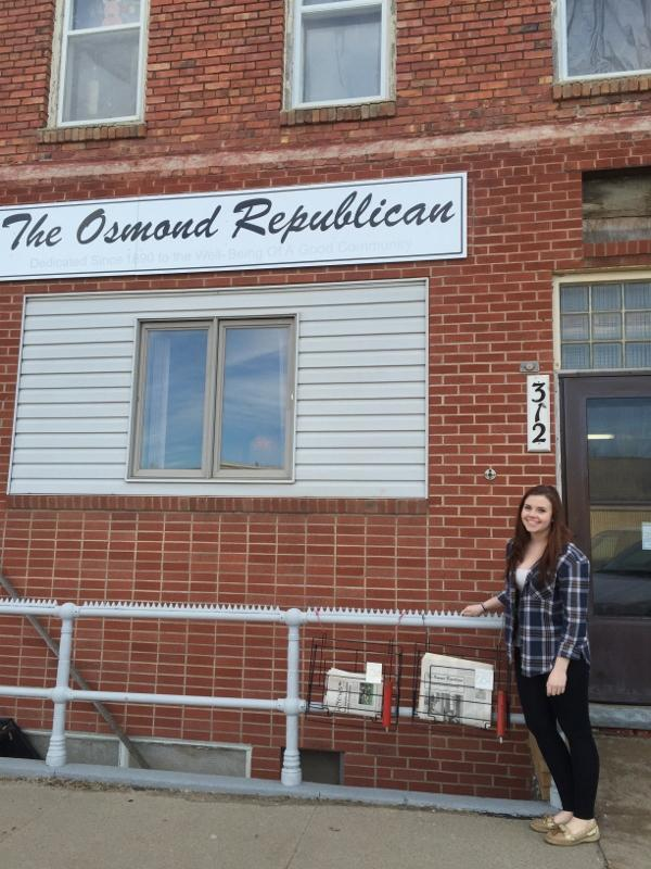 Marissa Lute stands in front of the former Osmond Republican building where generations of her family worked