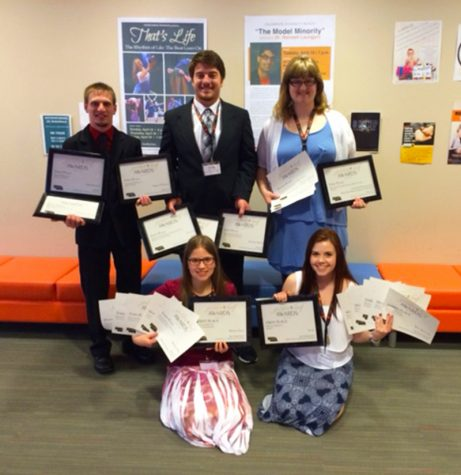 Northeast Community College broadcasting and mass media students hold the 28 awards they earned at the Nebraska Collegiate Media Association Golden Leaf Awards held recently at Doane College in Crete. Pictured in the first row (l-r) are Monika Zuch, Fremont and Marissa Lute, Laurel of The Viewpoint – Northeast's online college newspaper. Back row (l-r) are Josh Spanjer, Aurora; Cody Ronnfeldt, Gibbon; and Kallie Hanson, Yankton, SD, of KHWK, Northeast's campus radio station, and Hawk TV, the campus television station. (Courtesy Northeast Community College)