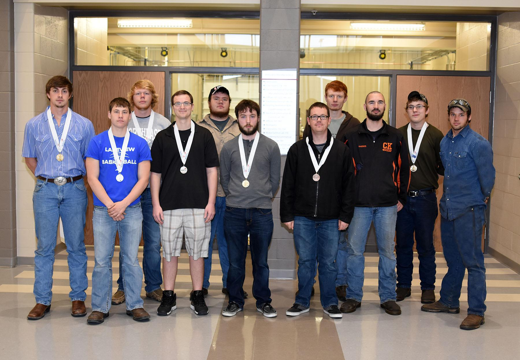 PHOTO CUTLINE – SkillsUSA Team  Northeast Community College's SkillsUSA Chapter was recognized as the state chapter that grew by the largest percentage of members in one year at the Nebraska SkillsUSA State Leadership and Skills Conference recently in Omaha. Pictured (from left) are James Buresh, Marcus Holmberg, Chase Orender, Jordan Zach, Trent Dolezal, Clint Jurgens, Tony Elder, Luke Kleinschmit, Morgan Barnes, Ian Folkers and Matthew Hilkemann. Buresh, Folkers, Jurgens and Orender were named state champions in their respective competitions of HVAC, diesel equipment technology, internetworking and sheet metal and have quailed for the national competition in Louisville, KY, in June. (Courtesy Photo)