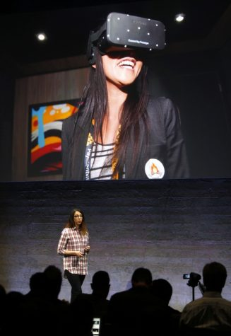Anna Sweet, head of developer strategy at Oculus, helps introduces the Rift virtual reality headset during a media event at Oculus in San Francisco, Calif., on Thursday, June 11, 2015. (Karl Mondon/Bay Area News Group/TNS)