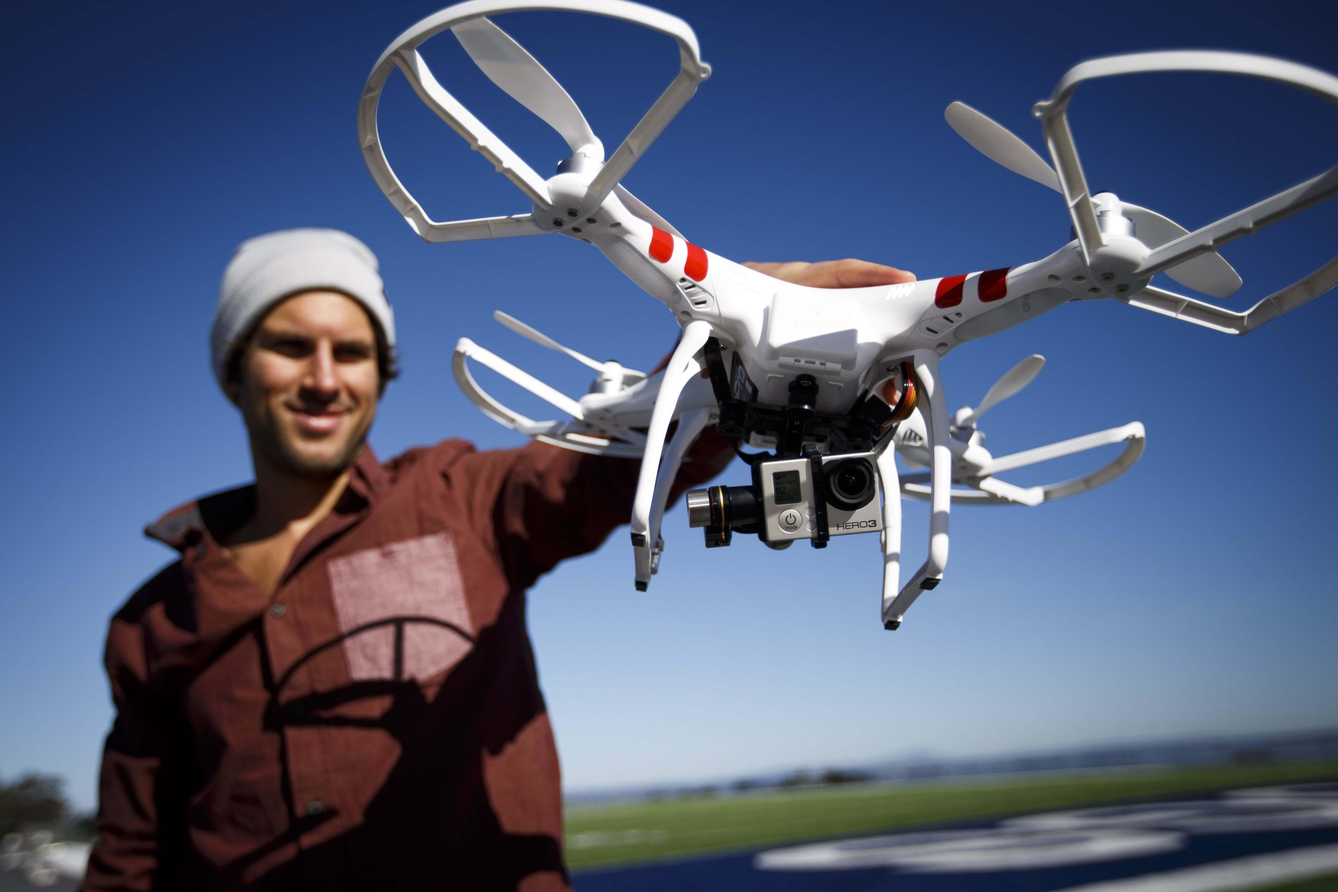 GoPro's senior production artist Abe Kislevitz demonstrates how to use a drone with a GoPro camera in San Mateo, Calif. The drone, named Phantom, is made by DJI. (Dai Sugano/Bay Area News Group/MCT)