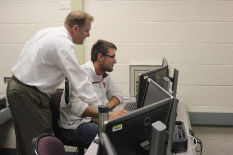 Tillotson works with student Colin Ortmeier