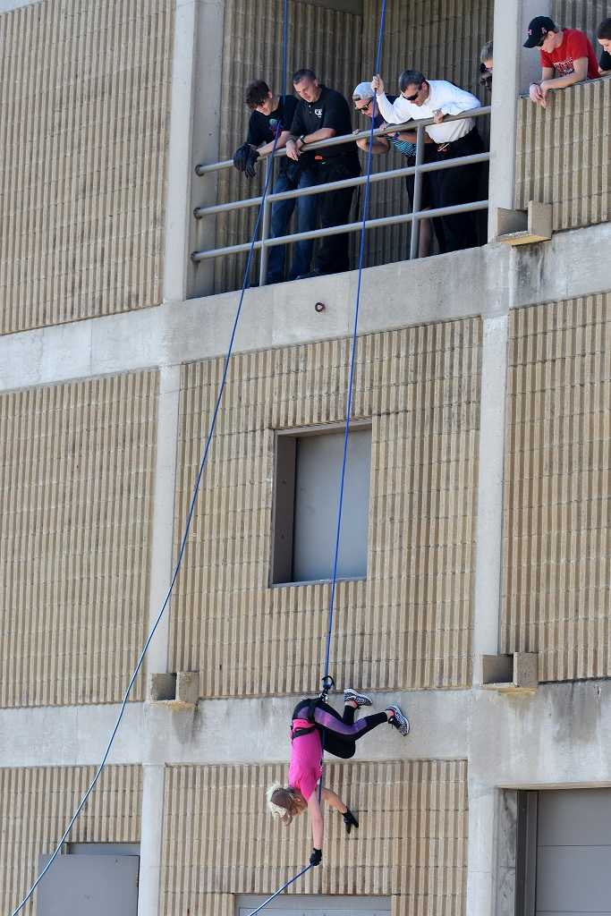 Shelby Schmidt, West Point, a freshmen criminal justice student at Northeast Community College, rappels down the side of the Norfolk Fire Division's Training facility during a training exercise recently. Approximately 25 students took part in the exercise. (Courtesy Northeast Community College).