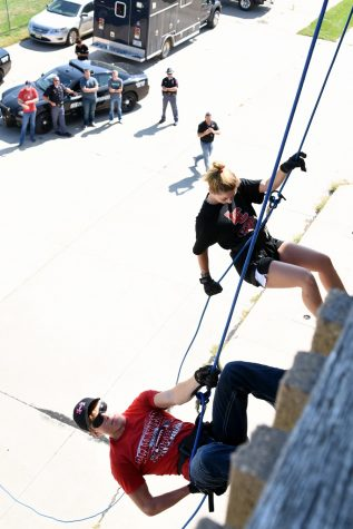Schuyler Sauser, Plainview, and Madalynn Haschke, Spalding, freshmen criminal justice students at Northeast Community College, rappel down the side of the Norfolk Fire Division's Training facility during a training exercise recently. Members of the Nebraska State Patrol's Troop B SWAT Team assisted in the exercise which featured approximately 25 students (Courtesy Northeast Community College).