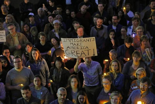 Hundreds protest at a vigil for refugees on Monday, Jan. 30, 2017 in Dallas, Texas at Thanksgiving Plaza. (Rodger Mallison/Fort Worth Star-Telegram/TNS)