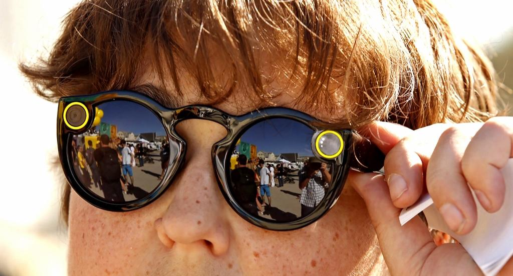 Andy Milonakis, 16, tries on Snap Spectacles on Nov. 10, the day they went on sale. (Al Seib/Los Angeles Times/TNS)