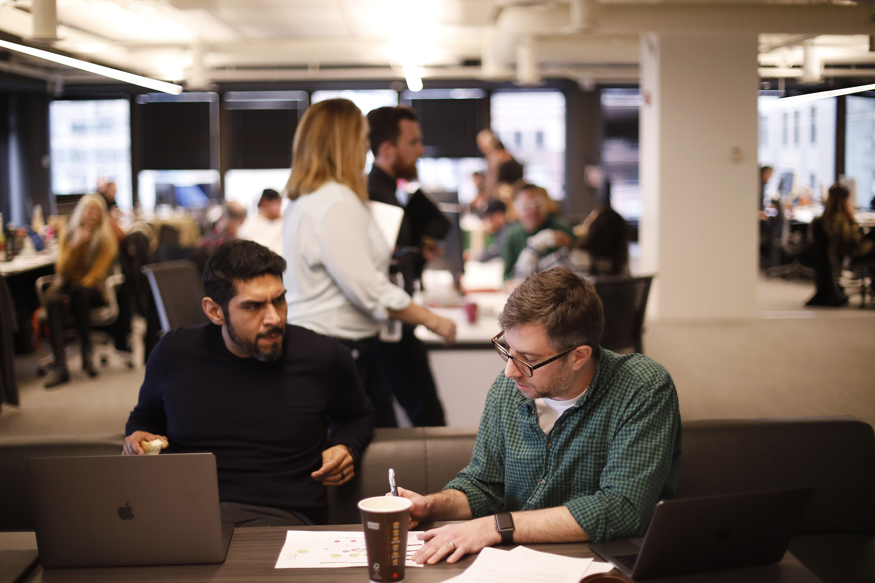 Vic Sanchez, left, and Jon Morgan, both creative directors, work on concepting at an open table space at We Are Unlimited, McDonald's new standalone advertising agency, on March 9, 2017 in Chicago. (Jose M. Osorio/Chicago Tribune/TNS)