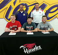 Jared Memec, Brennen Bales, and Andrew Hannah (l-r) have signed to play baseball next year at Northeast Community College. Also pictured are Tom Bales, baseball coach at Nebraska City High School, (left) and Marcus Clapp, baseball coach at Northeast. (Courtesy Northeast Community College)