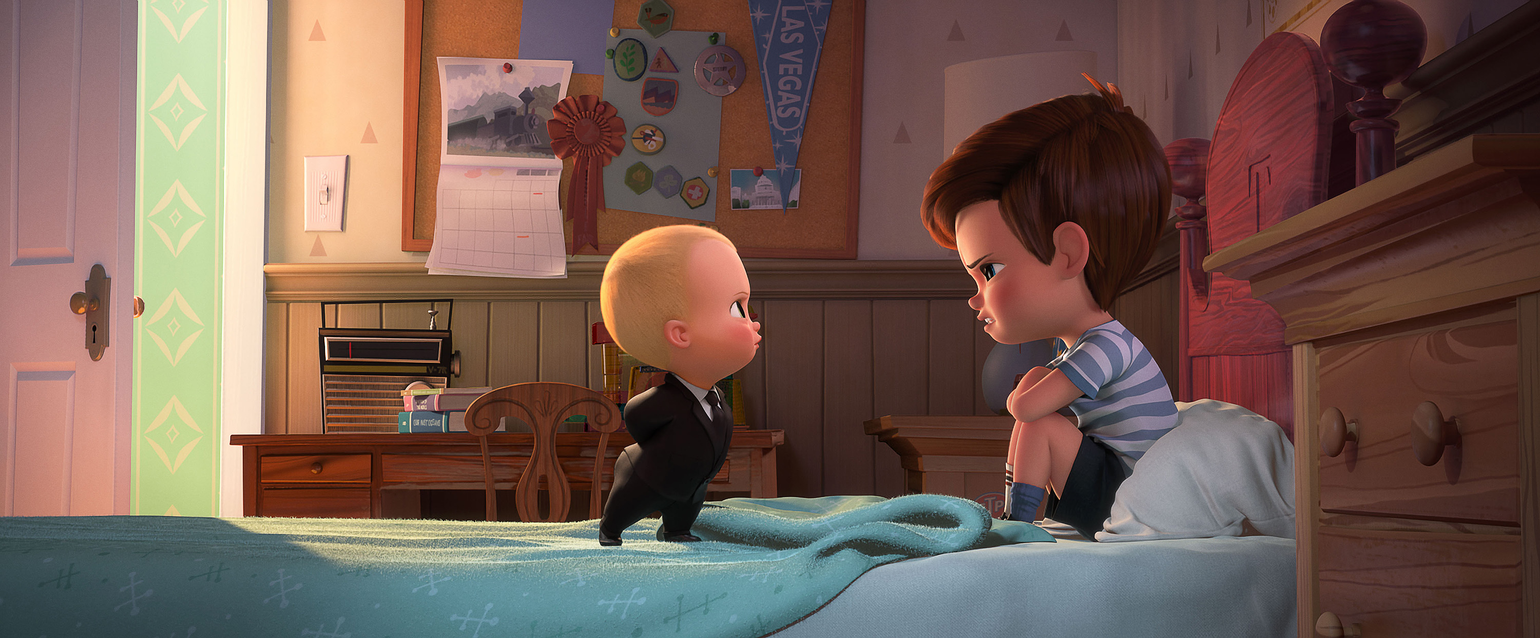 From left, Boss Baby, voiced by Alec Baldwin, tries to convince Tim, voiced by Miles Bakshi, that they must cooperate in DreamWorks Animation's