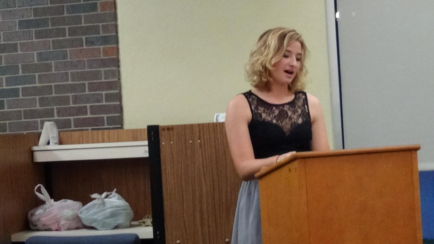 Rebecca Folda reads her poetry to the audience