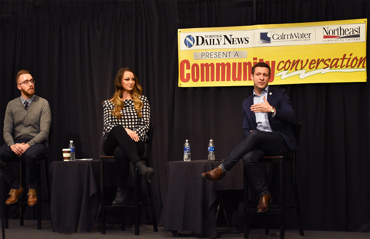Nebraska State Senator Adam Morfeld (right) speaks during a Community Conversation at Northeast Community College regarding the recruitment and retainment of young professionals to Nebraska. Looking on are Jeff Skalberg, of Omaha, and Brittnay Dawson, of Norfolk.