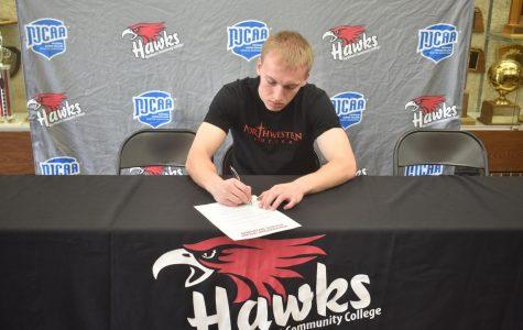 Aaron Wilken signs to Northwestern College